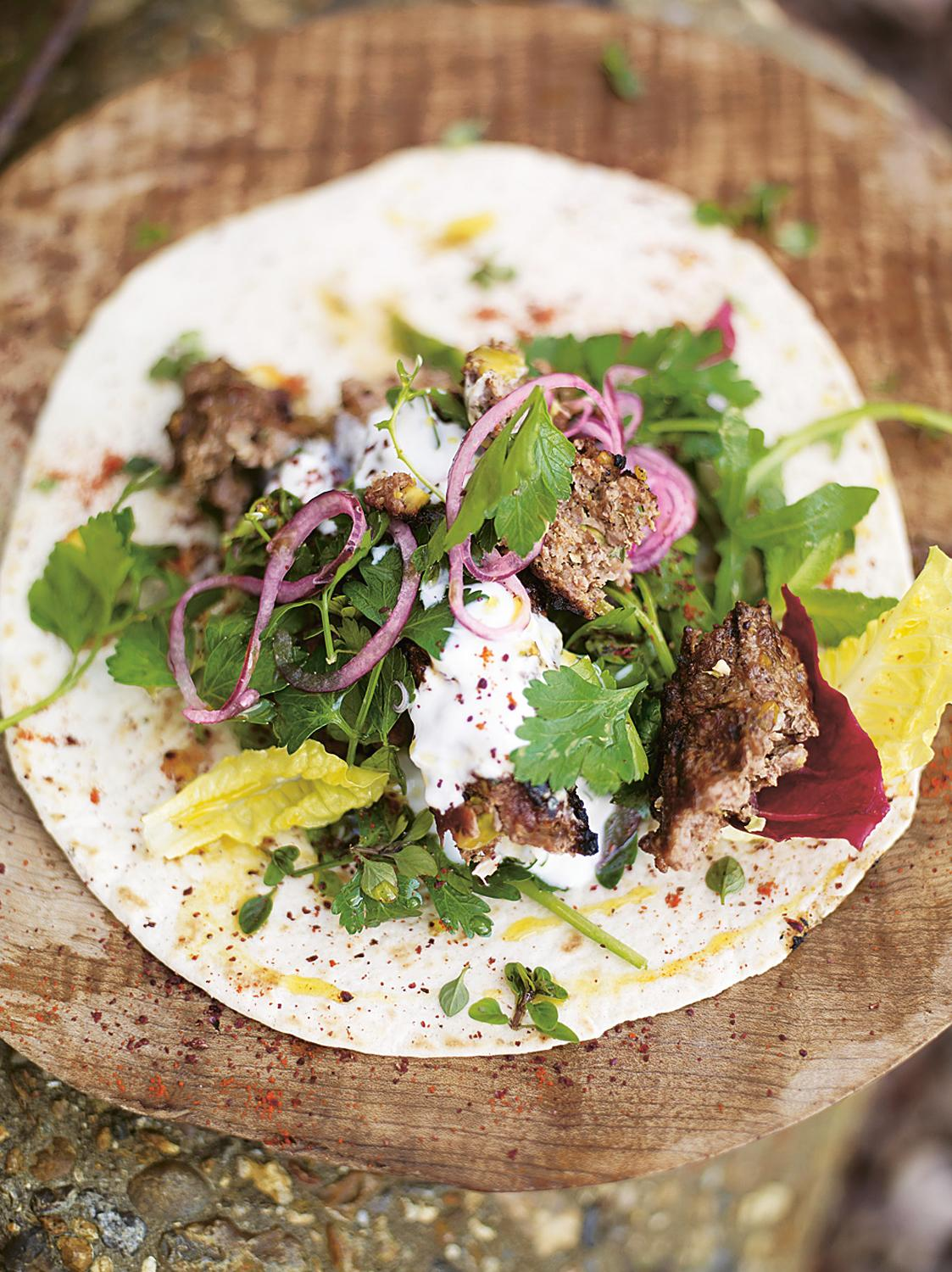 Grilled lamb kofta kebabs with pistachios & spicy salad wrap