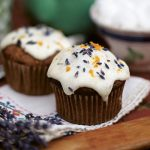cupcake with lavender and orange scattered on top with icing