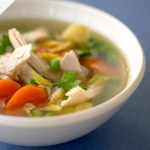 chicken soup with carrot, potato and herbs