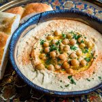 houmous with olive oil, chickpeas and bread for dipping