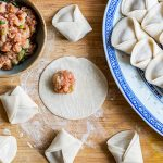 wonton soup recipe - homemade wontons being folded and wrapped