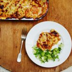 lasagne on a plate with salad