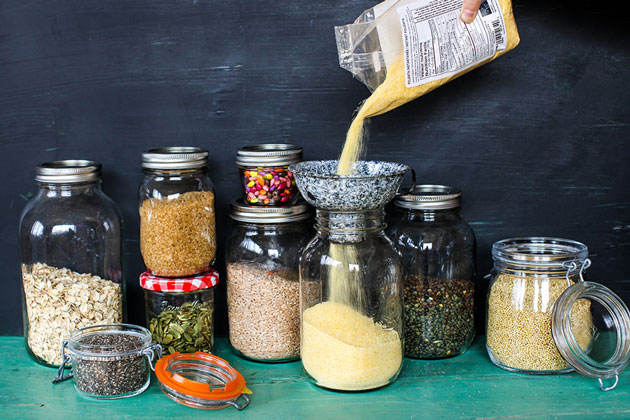 store-cupboard essentials stored in glass jars, all labelled