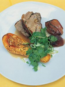Pot roasted shoulder of lamb with roasted butternut squash and sweet red onions