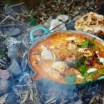 how to make curry sauce - Chicken curry on a outdoor fire