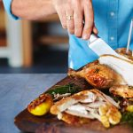 Healthy chicken recipe being sliced into pieces