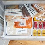 freezer drawer containing food all bagged with labels