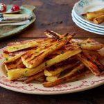 roasted parsnips on a plate with seasoning