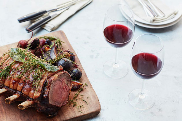 roast beef with vegetables on the side and wine