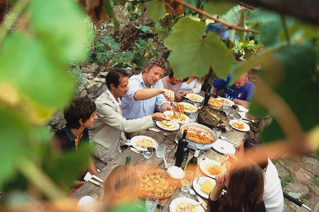 jamie and family dining in italy outside