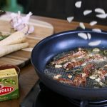 bertolli butter cooking garlic and bacon with parsnips on the side
