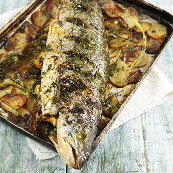 Whole roasted salmon with fresh soft herbs, lemon & potatoes