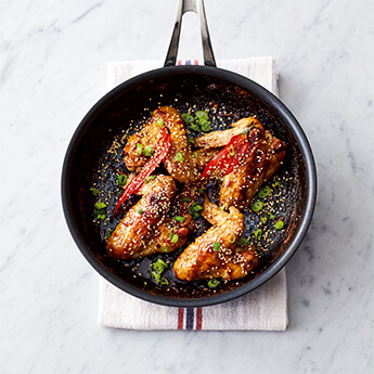 Sticky, spicy chicken wings from Jamie's latest book