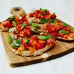 vegan summer recipe feature - tomato bruschetta with basil on top