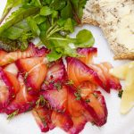 salmon recipe for gravlax with lemon, salad and bread with butter