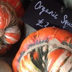 organic squash sign with different squash next to it