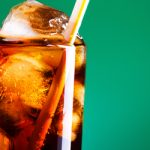 a glass of coke with ice in