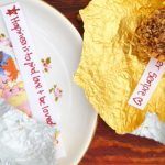 sweets wrapped in gold foil with messages inside
