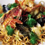 seafood noodle recipe with herbs and spices on top