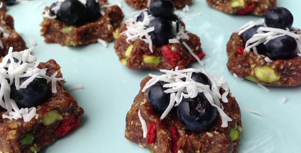 gluten free raw mince pies with fruit on top and coconut