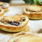 homemade mince pies baked with icing sugar on top