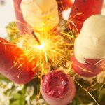 celebration cake with ice cream and fruit pops on top with sparklers