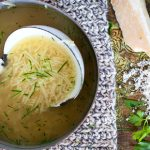 chicken noodle soup with grated parmesan on the side