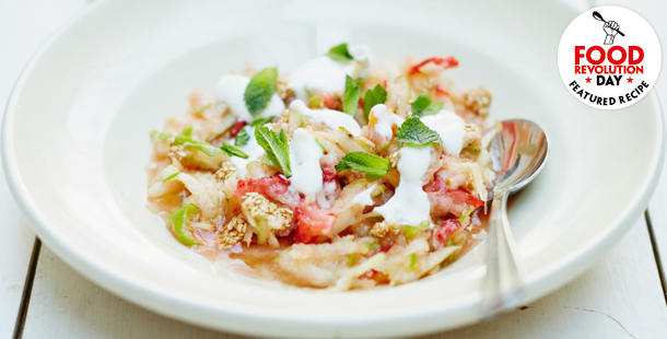 vegetable stew salad with yoghurt dressing on top