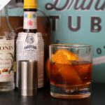 whiskey old fashioned with an orange peel in glass