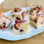 polish plum cake with icing sugar dusted on top and cut into slices
