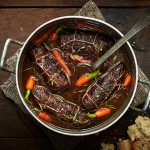 beef wrapped up in a stew with carrots