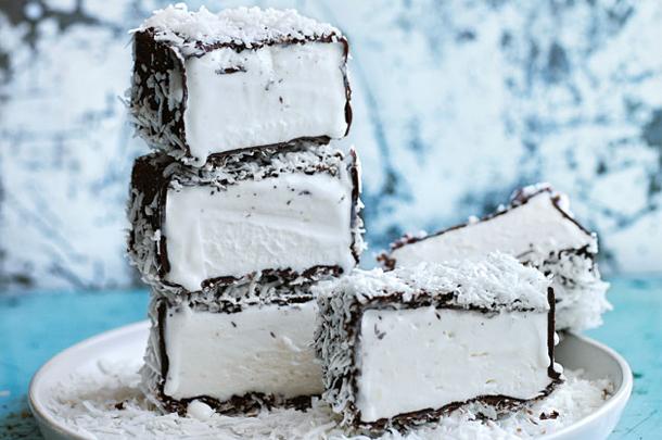 lamington ice cream bars with coconut shavings on top