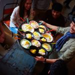 miss saigon cast holding food