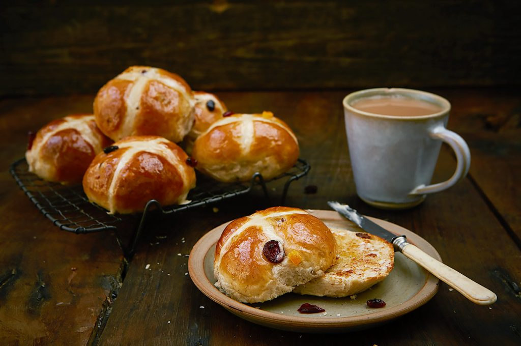 homemade hot cross buns toasted with butter and tea