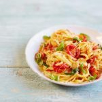 pasta with chopped tomatoes, herbs and grated cheese