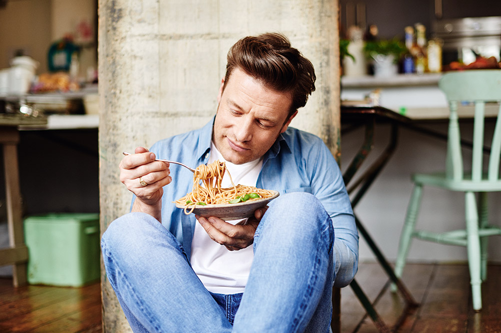 good carbohydrates - Jamie sat with a plate of pasta