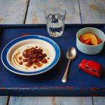 fruit breakfast, slices of orange and yoghurt with fruit on top