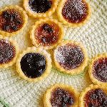jam tarts with icing sugar dusted on top