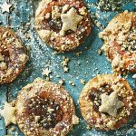 christmas pudding treats - mince pies with star pastry tops and icing sugar