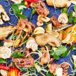 seafood feast grilled with tomato, chilli and salad