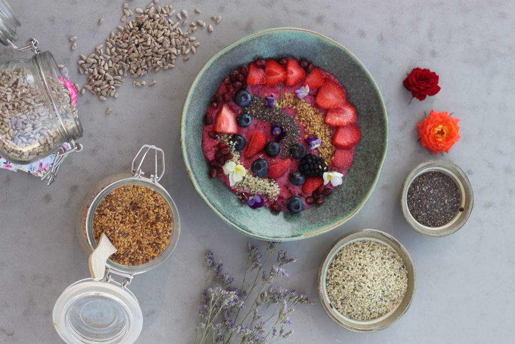omega feature - bowl of fruit with grains, seeds and oats
