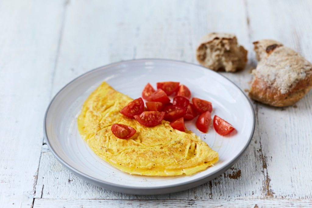 cheese omelette with chopped tomatoes and bread