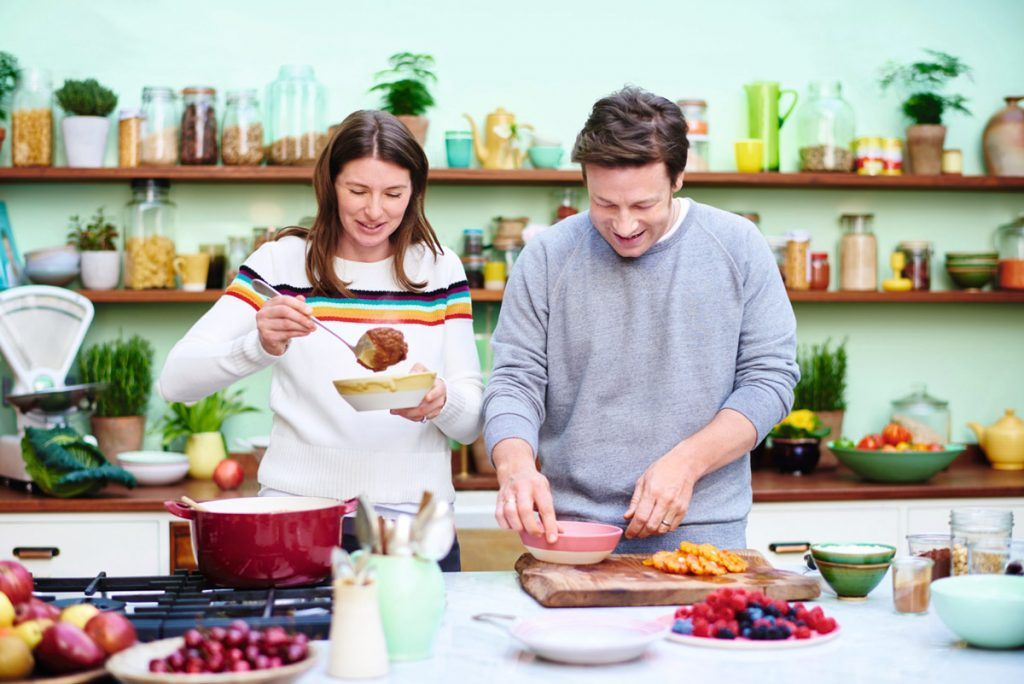 jamie and jools cooking food in their kitchen
