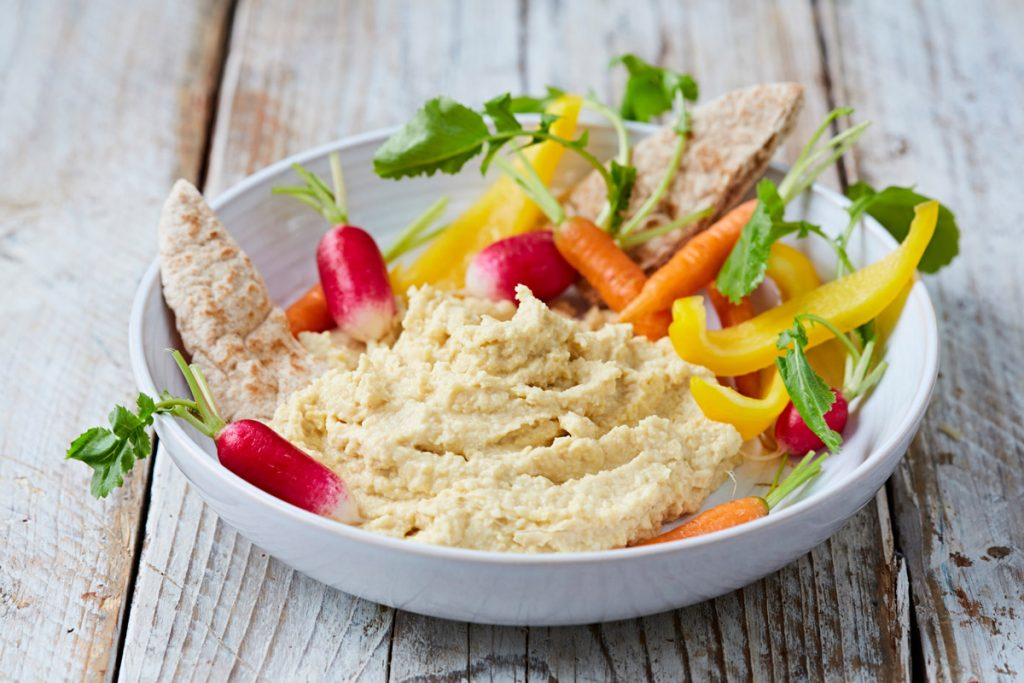 houmous with sliced veg and pitta slices for dipping