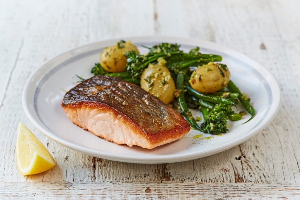 salmon with new potatoes and stemmed broccoli