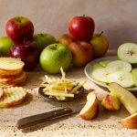 a variety of apples sliced in different ways