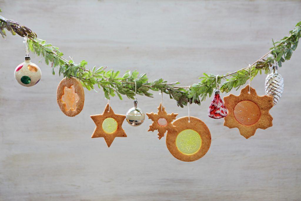 Christmas cookies hanging on a christmas tree branch