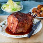 roast ham with glaze on table