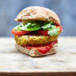 vegan burger with tomato, herbs, ketchup in a bun
