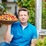 jamie oliver holding a bowl filled with home grown tomatoes - grow tomatoes feature